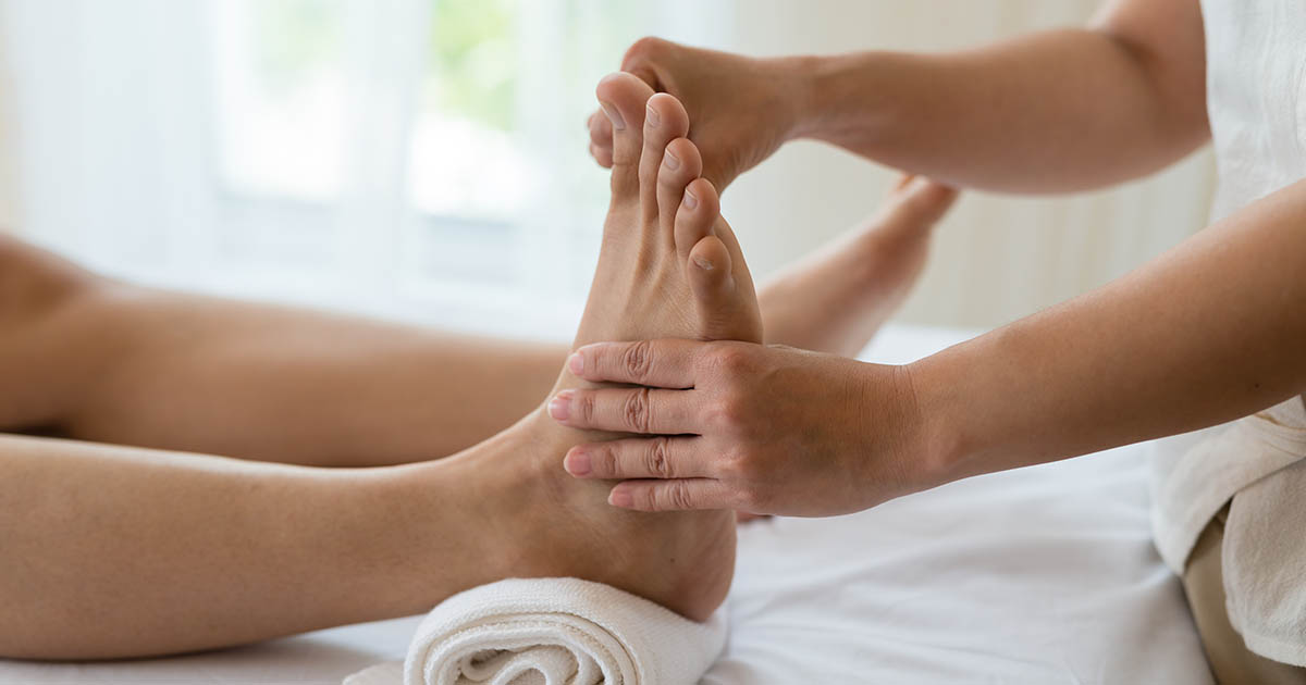 Reflexology being performed on a patient's foot