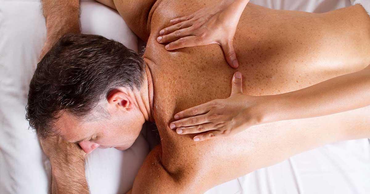 A man is receiving a back massage