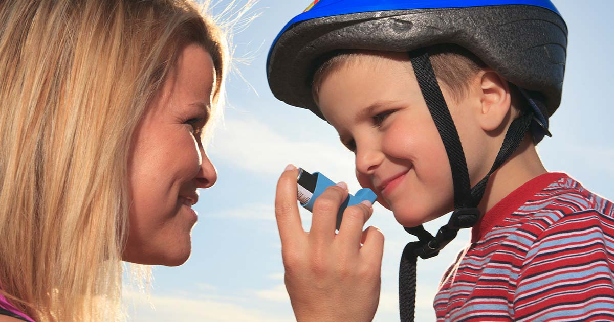 A mother is helping their asthmatic child