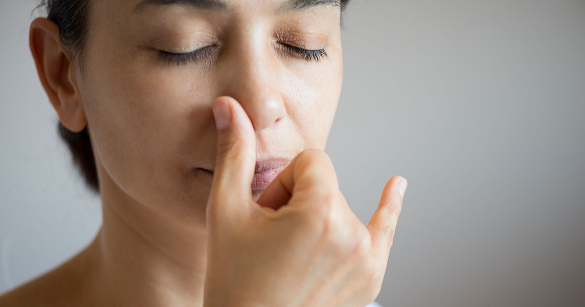 Woman doing breath therapy.