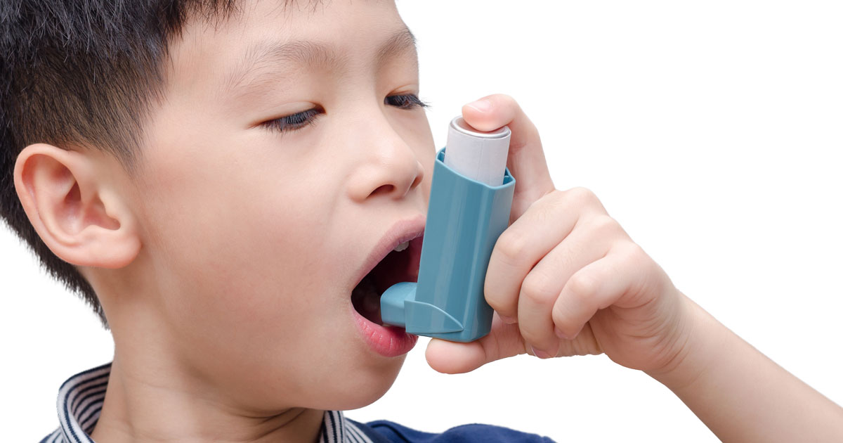 A child is using an inhaler