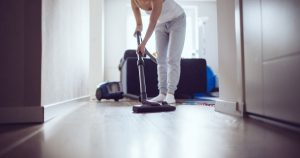 A person is vacuuming their home