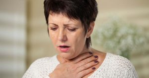 A woman is experiencing shortness of breath