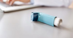 An asthma inhaler on a table
